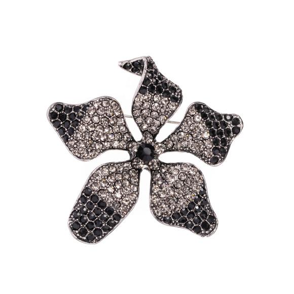 Błyszcząca broszka w kształcie kwiatu