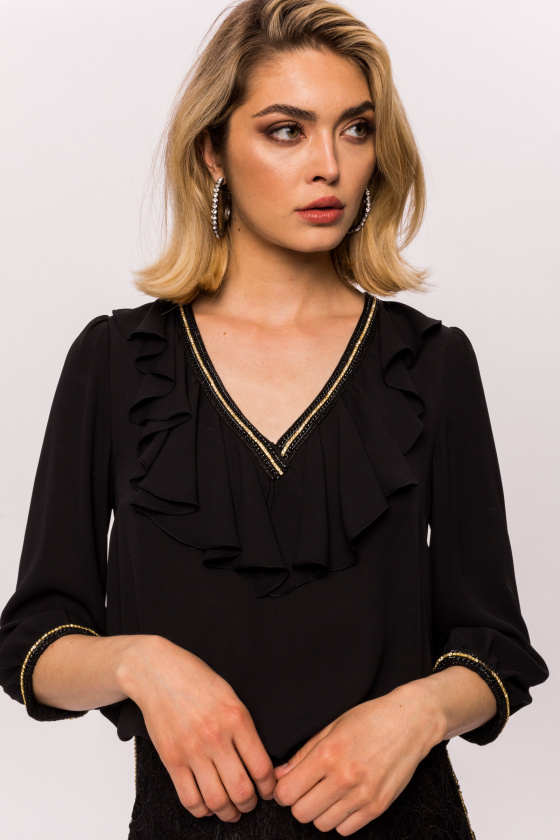 Elegant top with flounces and jewelry type applications