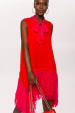 Asymmetrical silk dress with bow at the neck