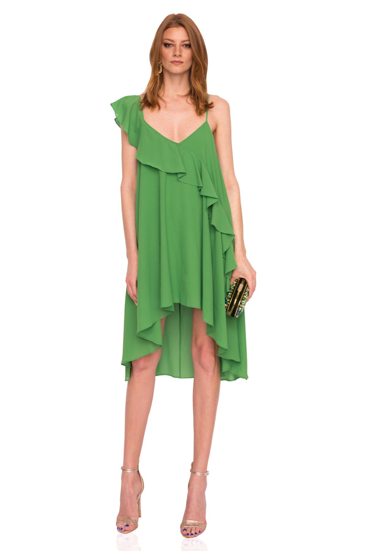 f0b772f235 Asymetryczna zielona sukienka z falbankami